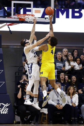 (AP Photo/Matt Slocum). Michigan's Isaiah Livers, right, goes up for a shot against Villanova's Joe Cremo during the first half of an NCAA college basketball game, Wednesday, Nov. 14, 2018, in Villanova.