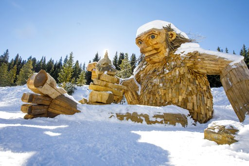 "(Hugh Carey/Summit Daily News via AP). The large wooden troll, ""Isak Hearthstone,"" made by artist Thomas Dambo during Breckenridge International Festival of the Arts in August, sits in the snow Wednesday, Nov. 14, 2018, along the Wellington Trail in Br..."