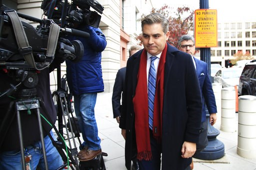 "(AP Photo/Manuel Balce Ceneta). CNN's Jim Acosta walks into federal court in Washington, Wednesday, Nov. 14, 2018, to attend a hearing on legal challenge against President Donald Trump's administration. Trump's administration contends it has ""broad dis..."