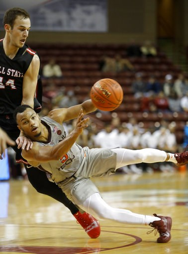 (AP Photo/Mic Smith). Virginia Tech's Justin Robinson, right, passes the ball as he falls against the defense of Ball State's Kyle Mallers in the first half of NCAA college basketball game at the Charleston Classic at TD Arena in Charleston, S.C., Thur...