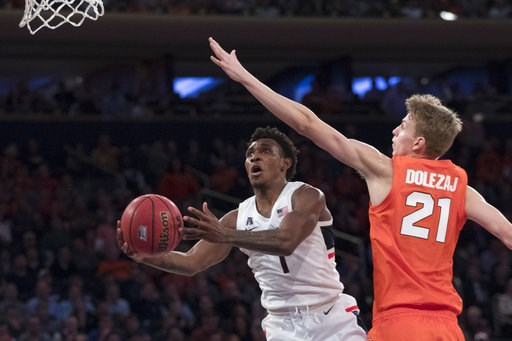 (AP Photo/Mary Altaffer). Connecticut guard Christian Vital (1) goes to the basket against Syracuse forward Marek Dolezaj (21) during the second half of an NCAA college basketball game in the 2K Empire Classic, Thursday, Nov. 15, 2018, at Madison Squar...