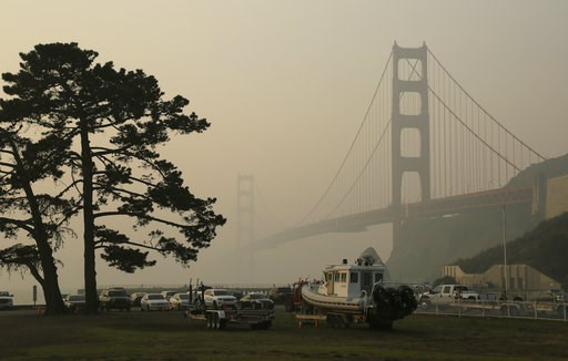 (AP Photo/Eric Risberg). The Golden Gate Bridge is obscured by smoke and haze from wildfires Friday, Nov. 16, 2018, in this view from Fort Baker near Sausalito, Calif.