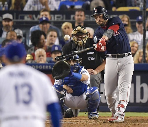(AP Photo/Mark J. Terrill, File). FILE - In this Oct. 28, 2018, file photo, Boston Red Sox's Steve Pearce, right, hits a home run against the Los Angeles Dodgers during the eighth inning in Game 5 of the World Series baseball game in Los Angeles. The R...