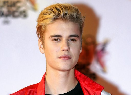 (AP Photo/Lionel Cironneau, File). FILE - In this Nov. 7, 2015 file photo, Justin Bieber arrives at the Cannes festival palace in Cannes, southeastern France. Bieber and a former neighbor whose house he egged have agreed to a settlement in a long-runni...