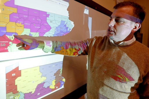 (AP Photo/Keith Srakocic). William Marx, points to projected images of the old congressional districts of Pennsylvania on top, and the new re-drawn districts on the bottom, while standing in the classroom where he teaches civics in Pittsburgh on Friday...