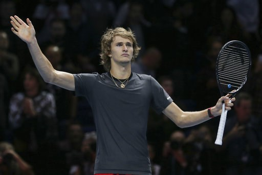 (AP Photo/Tim Ireland). Alexander Zverev of Germany celebrates winning match point against Roger Federer of Switzerland in their ATP World Tour Finals singles tennis match at the O2 Arena in London, Saturday Nov. 17, 2018.