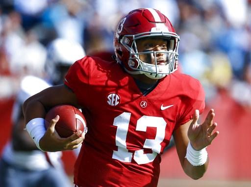 (AP Photo/Butch Dill). Alabama quarterback Tua Tagovailoa (13) carries the ball during the first half of an NCAA college football game against Citadel, Saturday, Nov. 17, 2018, in Tuscaloosa, Ala.