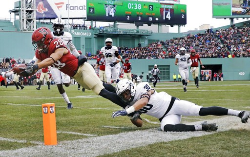 (AP Photo/Charles Krupa). Harvard wide receiver Henry Taylor (28) stretches for a touchdown against Yale linebacker Noah Pope (30) during the first half of an NCAA college football game at Fenway Park in Boston, Saturday, Nov. 17, 2018.
