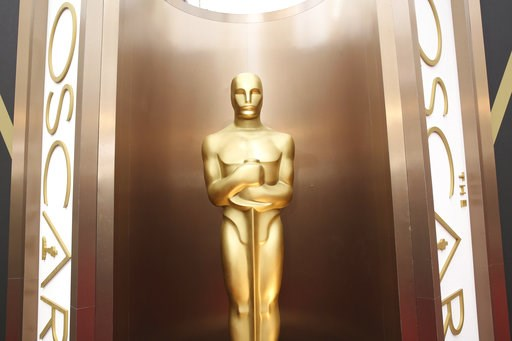 (Photo by Matt Sayles/Invision/AP, File). FILE - In this March 2, 2014 file photo, an Oscar statue is displayed at the Oscars at the Dolby Theatre in Los Angeles. This Sunday, Nov. 18, 2018, the film academy is preparing to honor the careers of a few H...
