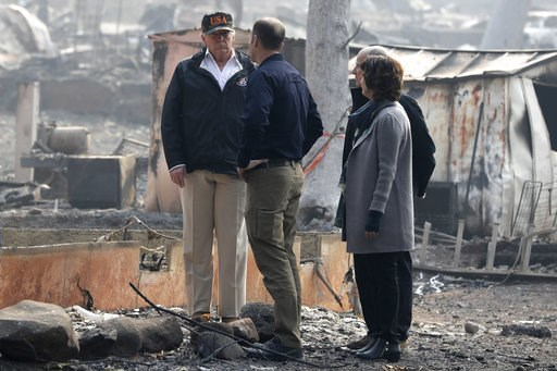 (AP Photo/Evan Vucci). President Donald Trump talks to FEMA Administrator Brock Long as he tours Paradise, Calif., California Gov. Jerry Brown and Paradise Mayor Jody Jones during a visit to a neighborhood impacted by the wildfires, Saturday, Nov. 17, ...