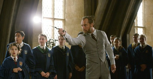 "(Warner Bros. Pictures via AP). This image released by Warner Bros. Pictures shows Jude Law in a scene from ""Fantastic Beasts: The Crimes of Grindelwald."""