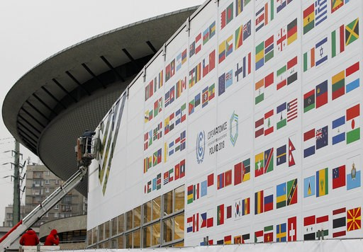(AP Photo/Czarek Sokolowski). In this Nov. 20, 2018 photo workers decorate the venue of the global climate summit that will be held at the site of the closed 'Katowice' coal mine in the city of Katowice, southern Poland, where - three years after seali...