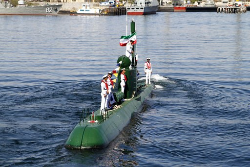 (Rahbar Emamdadi/Mehr News Agency via AP). In this photo provided by the semiofficial Mehr News Agency, Iran's navy members stand on Ghadir-942 submarine in southern port of Bandar Abbas, Iran, at the mouth of the strategic Strait of Hormuz, Thursday, ...