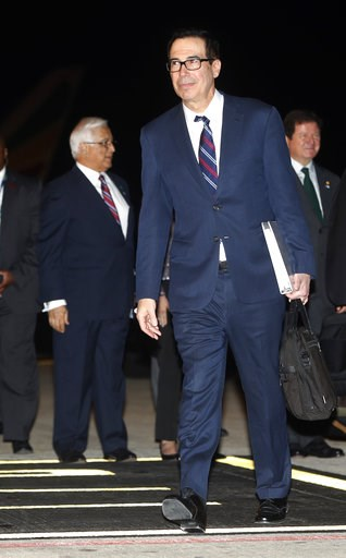 (AP Photo/Pablo Martinez Monsivais). U.S. Treasury Secretary Steven Mnuchin walks after arriving with President Donald Trump and first lady Melania Trump on Air Force One, Thursday, Nov. 29, 2018, as they arrive in Buenos Aires, Argentina. Trump travel...