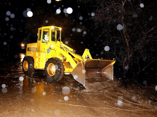 (AP Photo/Rich Pedroncelli). A scoop clears debris from a mudslide that partially blocked Honey Run Road, Thursday, Nov. 29, 2018, near Chico, Calif. Flash flooding hit Chico and nearby wildfire-scarred Paradise, forcing officials to deploy swift water...