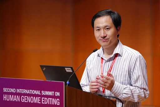(AP Photo/Kin Cheung). In this Nov. 28, 2018, photo, He Jiankui, a Chinese researcher, speaks during the Human Genome Editing Conference in Hong Kong. He made his first public comments about his claim to have helped make the world's first gene-edited b...