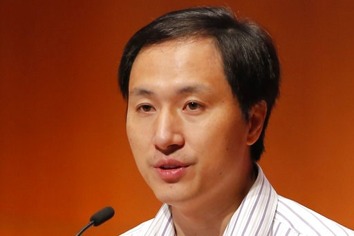 (AP Photo/Kin Cheung). He Jiankui, a Chinese researcher, speaks during the Human Genome Editing Conference in Hong Kong, Wednesday, Nov. 28, 2018. He made his first public comments about his claim to have helped make the world's first gene-edited babies.