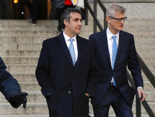(AP Photo/Julie Jacobson). Michael Cohen, left, walks out of federal court with his attorney Guy Petrillo, Thursday, Nov. 29, 2018, in New York, after pleading guilty to lying to Congress about work he did on an aborted project to build a Trump Tower i...