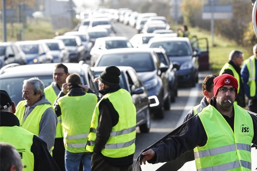 (AP Photo/Jean-Francois Badias, Fiule). FILE - In this Saturday, Nov. 17, 2018 file picture, demonstrators, known as the yellow jackets, block a roundabout as they protest against the fuel taxes, in Molsheim, eastern France. France's prime minister Edo...