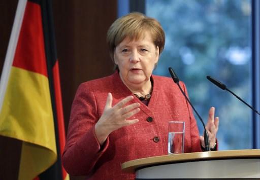 (AP Photo/Michael Sohn). German Chancellor Angela Merkel delivers a speech during the German Ukrainian Economy Forum in Berlin, Germany, Thursday, Nov. 29, 2018.