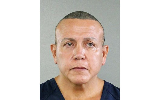 (Broward County Sheriff's Office via AP). FILE - In this undated photo released by the Broward County Sheriff's office, Cesar Sayoc is seen in a booking photo, in Miami.  A police report says mail pipe bomb suspect Cesar Sayoc was accused earlier in 20...