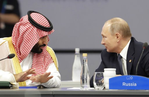 (AP Photo/Natacha Pisarenko). Saudi Arabia's Crown Prince Mohammed bin Salman, left, and Russia's President Vladimir Putin speak at the start of the G20 summit in Buenos Aires, Argentina, Friday, Nov. 30, 2018. The two leaders are controversial figures...