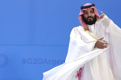 (AP Photo/Ricardo Mazalan). Saudi Arabia's Crown Prince Mohammed bin Salman adjusts his robe as leaders gather for the group at the G20 Leader's Summit at the Costa Salguero Center in Buenos Aires, Argentina, Friday, Nov. 30, 2018. The prince is a cont...