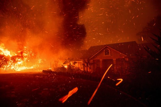 (AP Photo/Noah Berger, File). FILE - In this Thursday, Nov. 8, 2018, file photo, the Camp Fire rages through Paradise, Calif. U.S. Interior Secretary Ryan Zinke says wildfires in California in 2018, released roughly the same amount of carbon emissions ...