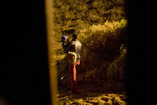 (AP Photo/Ramon Espinosa). A Honduran migrant walks with his son in his arms after jumping the wall to the U.S that separates Tijuana, Mexico and San Diego, in Tijuana, Mexico, Thursday, Nov. 29, 2018. Aid workers and humanitarian organizations express...