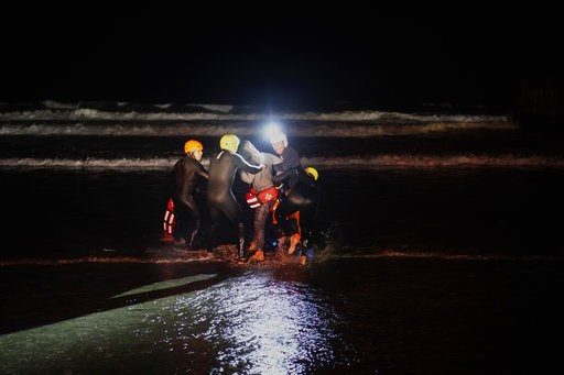 (AP Photo/Ramon Espinosa). Rescuers hold a Honduran migrant who tried to cross the U.S. border by the sea in Tijuana beach, Mexico, Thursday, Nov. 29, 2018. Aid workers and humanitarian organizations expressed concerns Thursday about the unsanitary con...