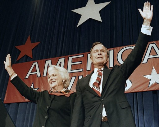 (AP Photo/Scott Applewhite, File). FILE - In this Nov. 8, 1988 file photo, President-elect George H.W. Bush and his wife Barbara wave to supporters in Houston, Texas after winning the presidential election. Bush has died at age 94. Family spokesman Jim...