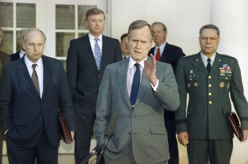 (AP Photo/Ron Edmonds, File). FILE - In this Feb. 11, 1991, file photo, President George H.W. Bush talks to reporters in the Rose Garden of the White House after meeting with top military advisors to discuss the Persian Gulf War. From left are, Defense...