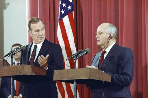(AP Photo/Jerome Delay, File). FILE - In this Oct. 29, 1991, file photo, President George H.W. Bush gestures during a joint news conference with Soviet President Mikhail Gorbachev,  at the Soviet Embassy in Madrid. Bush died at the age of 94 on Friday,...