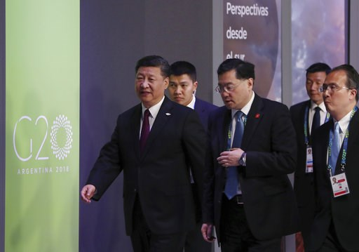 (AP Photo/Ricardo Mazalan). China's President Xi Jinping, left, enters for the start of the G20 summit in Buenos Aires, Argentina, Friday, Nov. 30, 2018. Heads of state from the world's leading economies were invited to the Group of 20 summit to discus...