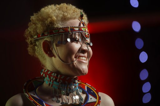 (AP Photo/Ben Curtis). Kenyan contestant Lucianah Nyawira, 21, wears a traditional costume as she performs in the Mr. & Miss Albinism East Africa contest, organized by the Albinism Society of Kenya, in Nairobi, Kenya Friday, Nov. 30, 2018. The even...