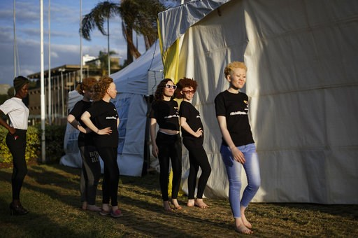 (AP Photo/Ben Curtis). Contestants practice their catwalk moves as they prepare for the Mr. & Miss Albinism East Africa contest, organized by the Albinism Society of Kenya, in Nairobi, Kenya Friday, Nov. 30, 2018. The event aims to promote social i...
