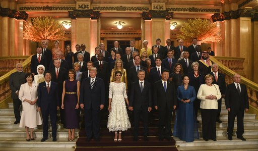(G20 Press Office via AP). In this photo released by the press office of the G20 Summit, leaders and their partners pose for a group photo prior to a gala dinner at the Colon Theater in Buenos Aires, Argentina, Friday, Nov. 30, 2018. Leaders from the G...