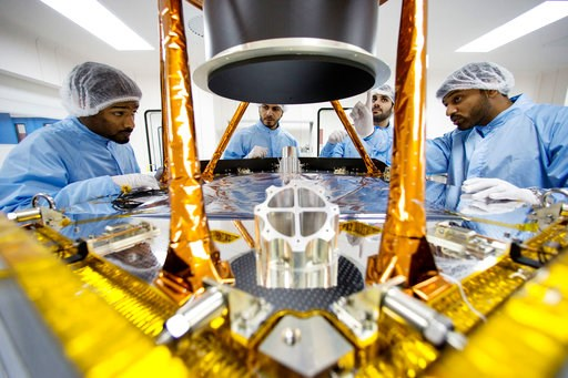 (United Arab Emirates Space Agency via AP). In this undated photo provided by the United Arab Emirates Space Agency, engineers discuss further steps to disassemble a spacecraft's sun shield baffle for further inspections. As Mars' newest resident settl...
