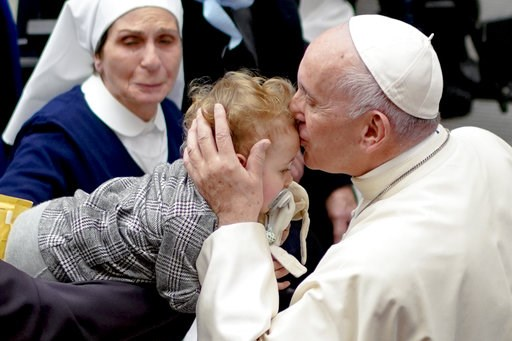 (AP Photo/Andrew Medichini). Pope Francis kisses a baby during an audience for members of the diocesis of Molfetta and Ugento-Santa Maria di Leuca, at the Vatican, Saturday, Dec. 1, 2018.