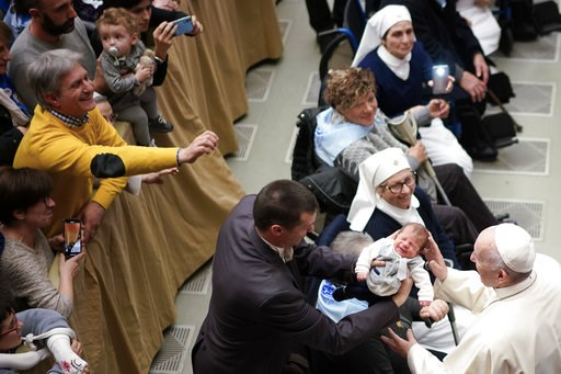 (AP Photo/Andrew Medichini). Pope Francis caresses a baby during an audience for members of the diocesis of Molfetta and Ugento-Santa Maria di Leuca, at the Vatican, Saturday, Dec. 1, 2018.
