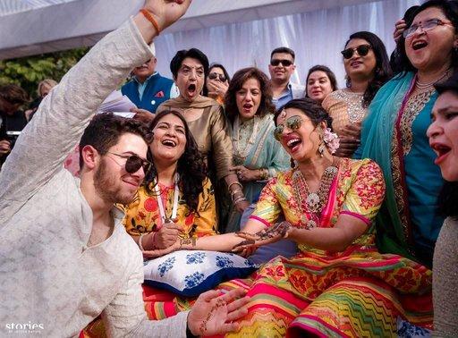 (PTI12_1_2018_000197A). Jodhpur : HANDOUT: Friday, Nov. 30, 2018 Bollywood actress Priyanka Chopra and Nick Jonas celebrate during their mehendi ceremony, a day before their wedding, at Umaid Bhawan in Jodhpur, Rajasthan, Friday, Nov,30, 2018. (PTI Pho...