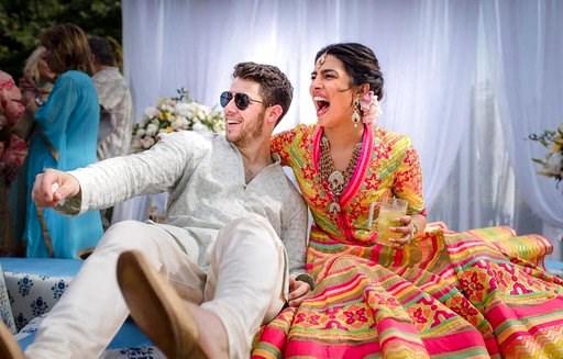 (Raindrop Media via AP). In this Friday, Nov. 30, 2018 handout photo released by Raindrop Media, Bollywood actress Priyanka Chopra and Nick Jonas celebrate during a mehendi ceremony, a day before their wedding, at Umaid Bhawan in Jodhpur, India.