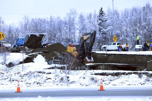 (AP Photo/Dan Joling). A dump truck and excavator work on a temporary fix of an off ramp that collapsed after an earthquake on Friday, Nov. 30, 2018, in Anchorage, Alaska. A driver attempting to exit Minnesota Drive at International Airport Road was no...