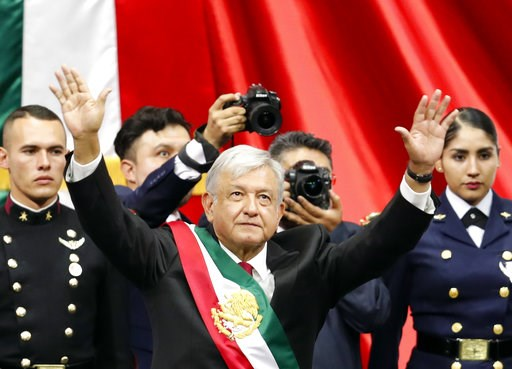 (AP Photo/Eduardo Verdugo). Mexico's new President Andres Manuel Lopez Obrador greets the crowd at the end of his inaugural ceremony at the National Congress in Mexico City, Saturday, Dec. 1, 2018. Mexicans are getting more than just a new president Sa...