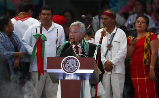 (AP Photo/Moises Castillo). Mexico's new President Andres Manuel Lopez Obrador delivers a speech at the Zocalo, in Mexico City, Saturday, Dec. 1, 2018. Mexicans are getting more than just a new president Saturday. The inauguration of Lopez Obrador will...