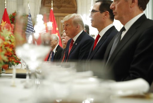 (AP Photo/Pablo Martinez Monsivais). President Donald Trump, center, and Treasury Secretary Steve Mnuchin, second from the right, listen to remarks by China's President Xi Jinping during a bilateral meeting at the G20 Summit, Saturday, Dec. 1, 2018 in ...
