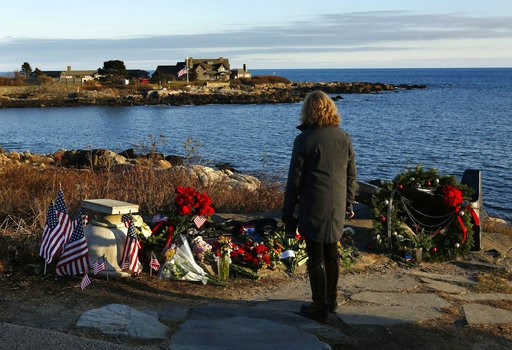 (AP Photo/Robert F. Bukaty). Cathy Rogers of Windham, Maine, pays her respects at a makeshift memorial for President George H. W. Bush across from Walker's Point, the Bush's summer home, Saturday, Dec. 1, 2018, in Kennebunkport, Maine. Bush died at the...