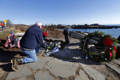 (AP Photo/Robert F. Bukaty). A man pays his respects to former President George H. W. Bush at a makeshift memorial across from Walker's Point, the Bush's summer home, Saturday, Dec. 1, 2018, in Kennebunkport, Maine. Bush died at the age of 94 on Friday...