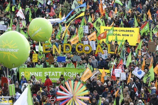 (Henning Kaiser/dpa via AP). Demonstrators take part in a climate demonstration in Cologne, Germany, Saturday, Dec. 1, 2018. Thousands of people are marching in Berlin and Cologne to demand that Germany make a quick exit from coal-fired energy, a day b...