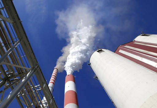(AP Photo/Darko Vojinovic). In this photo taken Wednesday, Oct. 3, 2018, smoke rises from the chimneys of Serbia's main coal-fired power station near Kostolac, Serbia. The Kostolac power plant complex in eastern Serbia is currently being expanded with ...